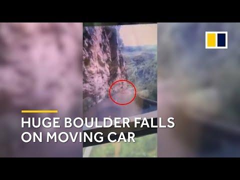 Falling boulder hits car in China
