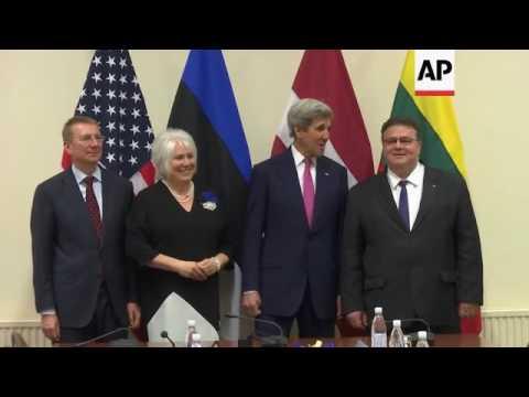 Kerry meets NATO chief; NATO family photo