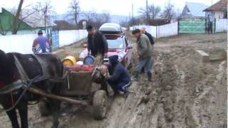 Joe's car is rescued by a Horse And Cart in Village of in Mānāstirea Romania