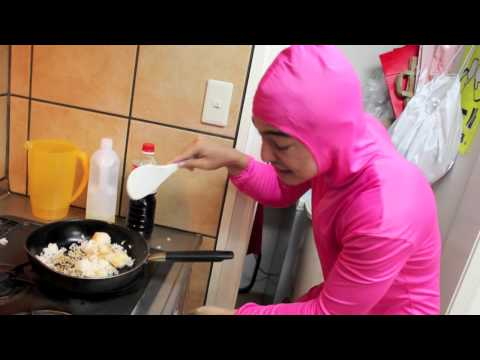 PINK GUY COOKS FRIED RICE AND RAPS