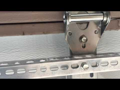 buckling popping garage door panel quick easy cheap repair