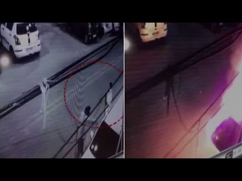 Caught on cam: Two men set SUV on fire