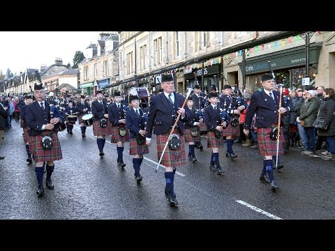 The Vale of Atholl Pipe Band 2018 New Years Day display during Pitlochry street party