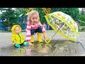 Milusik and her doll Playing In The Rain