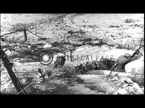Italian troops advance with tanks and fire artillery at Tunisian Front. HD Stock Footage