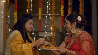 Indian women eating sweets at the festival - celebration concept. Diwali festivities