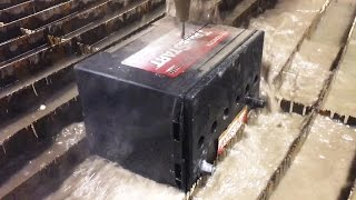 A Car Battery and Alternator cut in half With A Waterjet