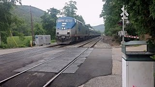 Amtrak passes Metro North at Manitou
