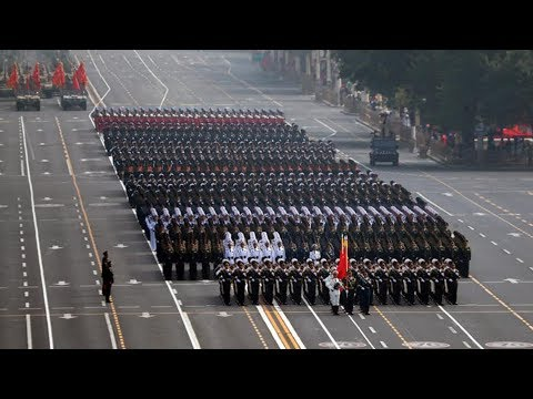Fifteen military units march in formation for National Day parade