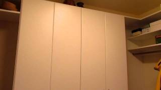 Master Storage Closet With White Slab Doors