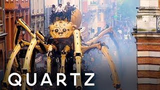 Giant spider and minotaur robot puppets on the streets of France