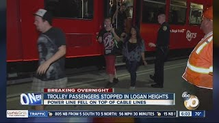downed power line traps trolley passengers