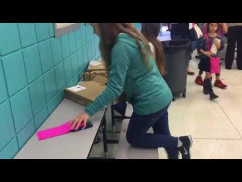 Students break into their new Chromebooks at Surfside Middle School Tuesday morning
