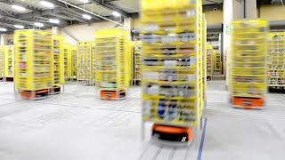 倉庫の中を縦横無尽 アマゾンの動く棚ロボ