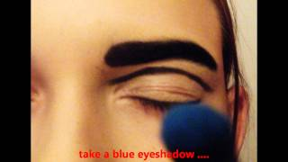 creative makeup - electric blue,yellow and black eyeshadow Thumbnail