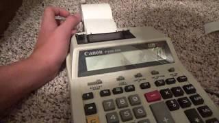 A Texas Instruments Scientific Calculator and a Canon Printing Calculator