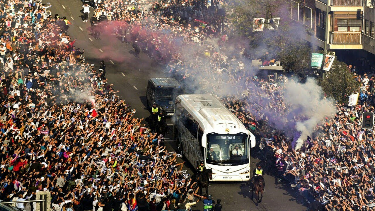 THOUSANDS of Real Madrid fans welcome their team bus to ...