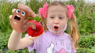 Nastya and dad pick vegetables on the farm for mom