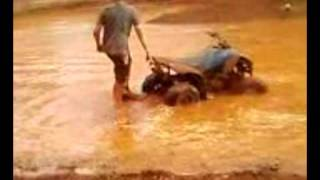 motor bike and quad stuck in mud