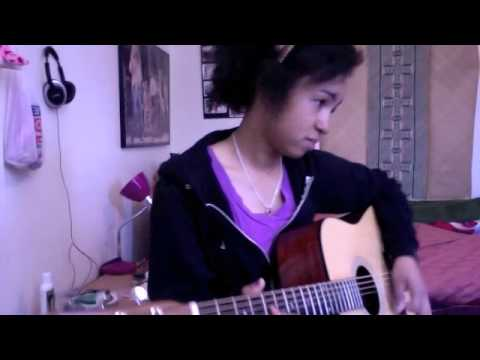 "A Young Malagasy lady plays ""Old Man"" by Neil Young in Spanish."