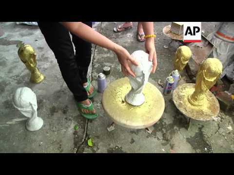 pottery-craftsman-gains-popularity-with-his-ceramic-replica-of-the-golden-world-cup-trophy