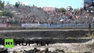 Russia: Tractors get mucky in off-road derby