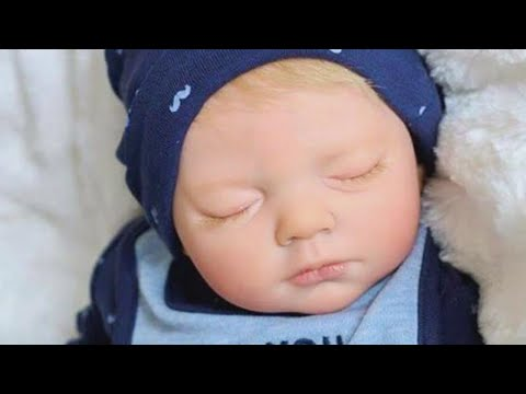 Dad Breaks Down in Tears Over Replica Doll of Stillborn Baby