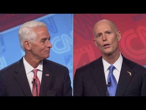 Crist and Scott debate jets and mansions