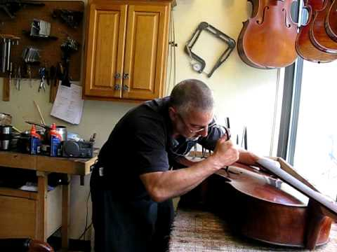 Andy Fein Setting a Cello Soundpost to a Bach Cello Suite at Fein Violins