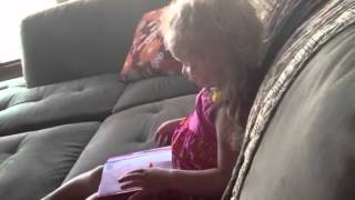 Olivia reading once upon a potty
