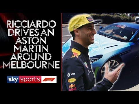 Daniel Ricciardo drives Martin Brundle around in a spray painted Aston Martin