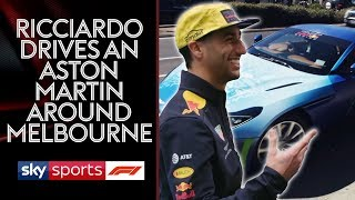 Daniel Ricciardo drives Martin Brundle around in a spray painted Aston Martin