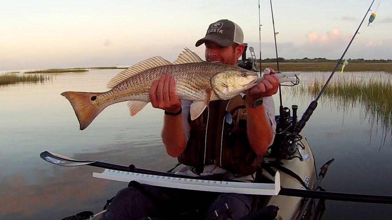 Kayak fishing huge slot redfish snaps rod youtube for Red fishing rod