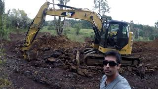 Cat Excavator Ripping Rock and Pushing Tree Over