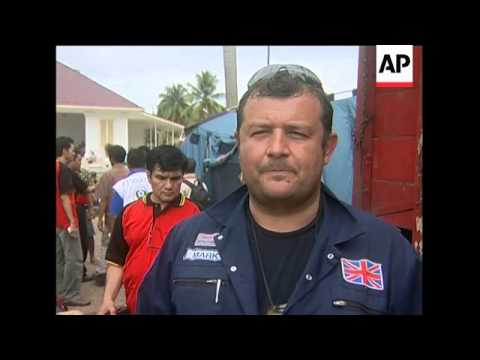 wrap-aid-workers-on-clean-up,-us-aid-plane;-japan-medical-team
