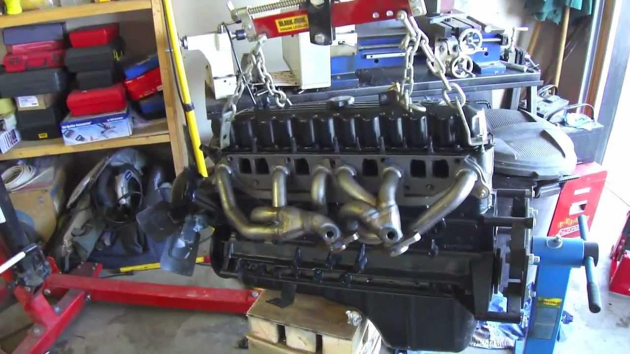 Jeep Tj 4.0l Banks Torque Tube Header install - YouTube