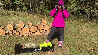 Young Lady Demonstrates How Easy It Is To Split Big Firewood Logs With Manual Hydraulic Log Splitter