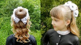 Прическа с украшением на гульку-пучок / Hair decoration on a bun(Всем привет! С Вами Оля Лигус и моя дочь Ирина. В этом видео мы покажем как сделать прическу и дополнить её..., 2016-05-30T10:19:21.000Z)