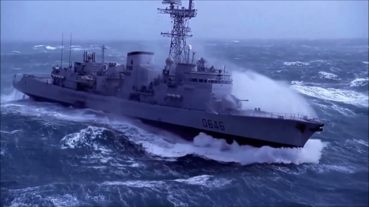 military ship in extreme storm doovi