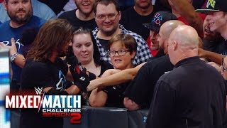 AJ Styles Woos the crowd following Fenomenal Flair's Mixed Match Challenge victory
