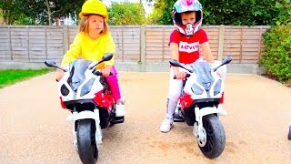 Kids play racers on ride on toy motorbikes