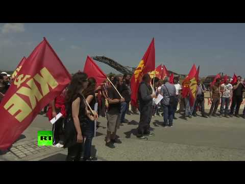 'NATO killers go home': Protest against Akrotiri airbase in Cyprus following Syria strikes