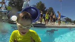 photo of young boy wearing goggles at the pool