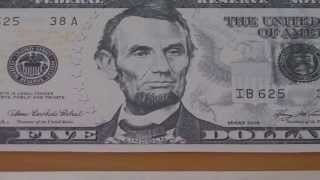 Who was Abraham Lincoln ? - The 5 US-Dollar banknote