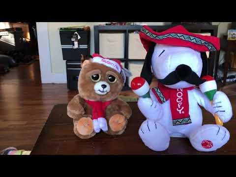 "Feisty Pet's Ebenezer Claws and Snoopy singing ""Feliz Navidad"""