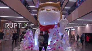 China: Shopping centre brings in Year of the Dog with Trumpesque statue