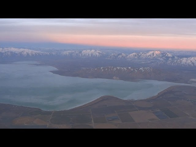 Aerial, arriving views of Salt Lake City area mountains on approach to SLC airport - DL 737