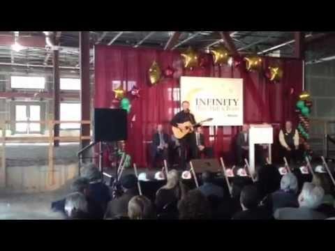 Musician Jonathan Edwards plays at Infinity Hall groundbreaking