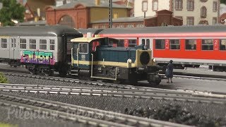 Model railroad layout by Marklin with German locomotives and trains in HO Scale