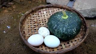 Survival skills: Eggs in the pumpkin burned in the ground for food - Cooking eggs eating delicious